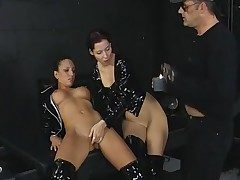 Threesome in the dungeon space with black spandex nymphs