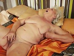 Granny with inordinately hairy pussy named Norma rubs crimson with a pioneering toy in be passed on afternoon