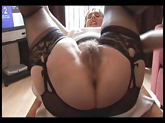 Furry busty mature lady in slide and girdle does upskirt and