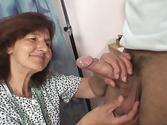 Sewing elder women swallows customer's lollipop
